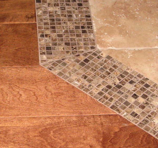 Use Smaller Tiles as a Threshold to Transition From Tile to Wood.