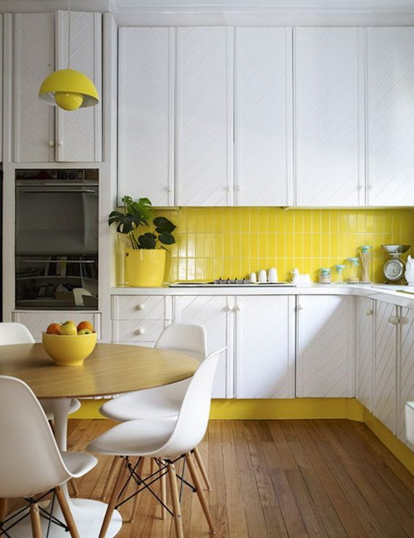 Yellow Subway Tile Backsplash against the Sleek White Cabinets