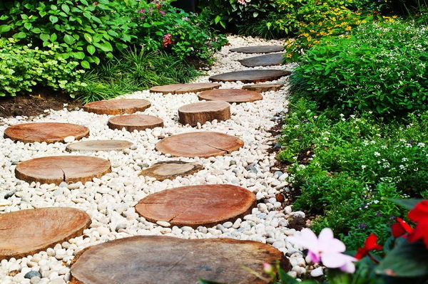Enchanting Pathway with Natural Logs and White Gravel.
