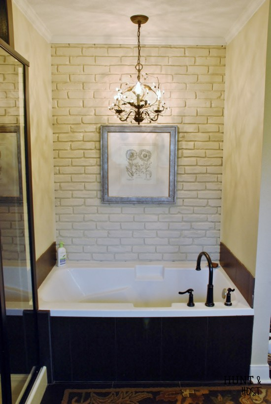 White Brick Accent Wall In The Bathroom.