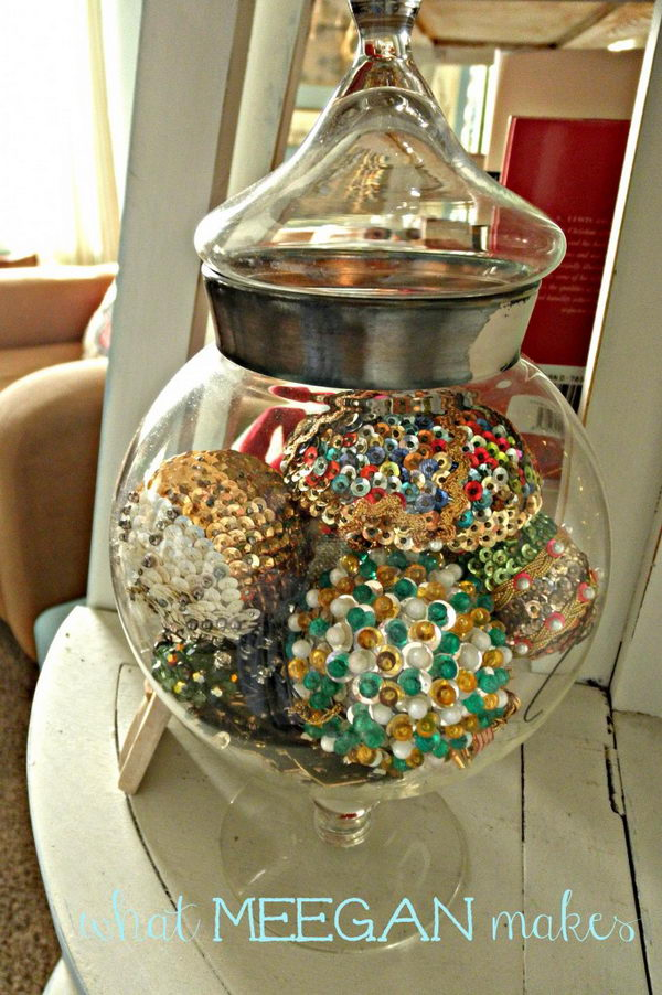 Christmas Decoration With Sequin Ornaments Placed In An Apothecary Jar.