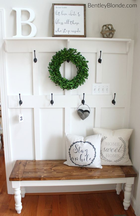 DIY Farmhouse Entryway Bench and Whitewashed Board Wall With Coats.