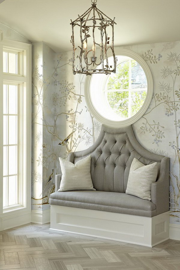 Small Entryway with Upholstered Bench, Antique Pendant Light and Round Window Design.