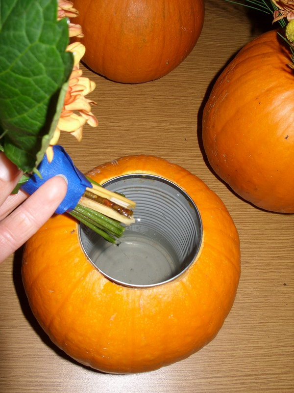 Carve Out A Pumpkin And Place A Metal Can For Flower Arrangement.