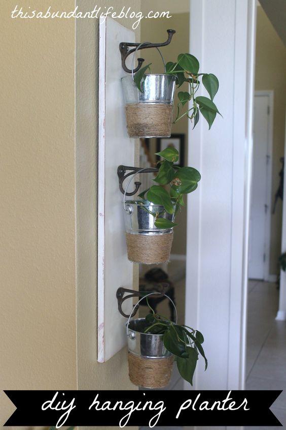 DIY Hanging Planter Using Dollar Store Buckets.