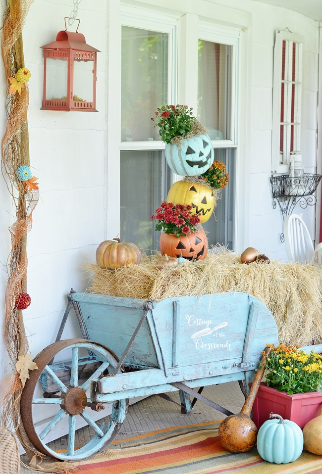 Aqua Painted Wheelbarrow With Topsy Turvy Stacked Pumpkins In.
