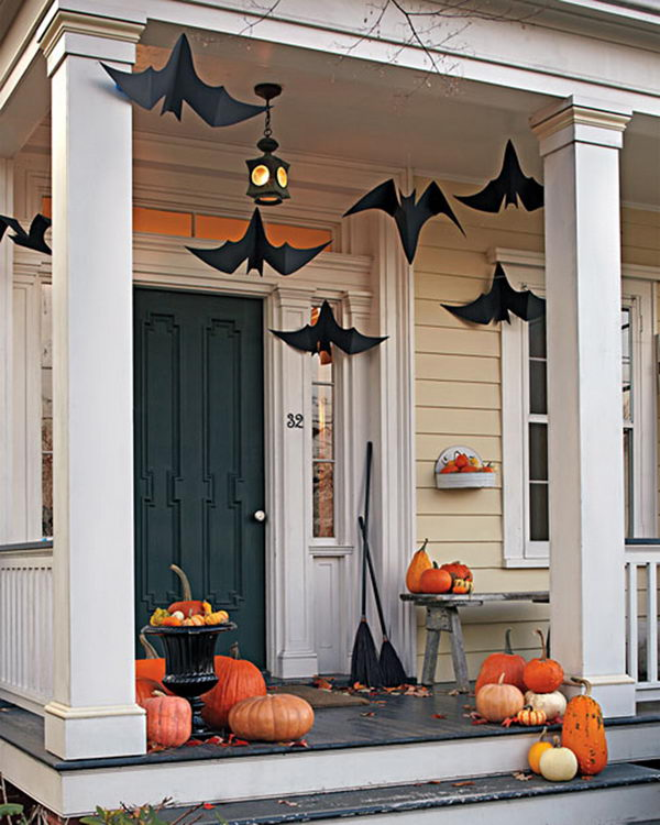 Halloween Porch Deocration Using Hanging Black Bats And Witch Brooms.