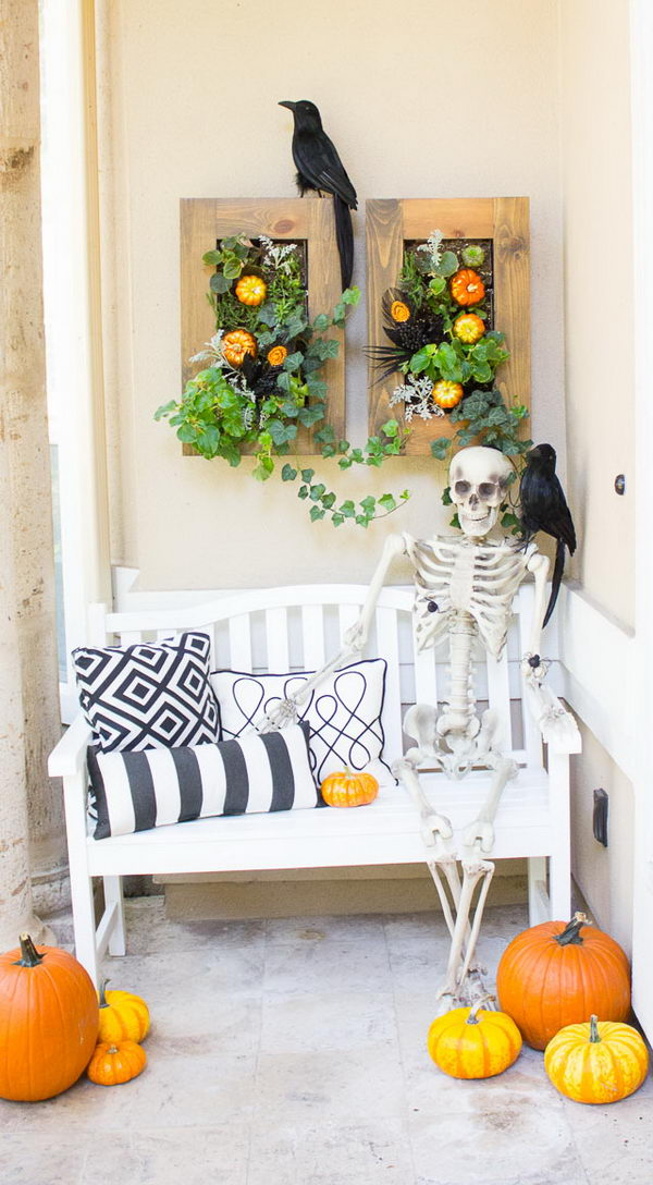 Spooky Halloween Front Porch With Raven And Skeleton.
