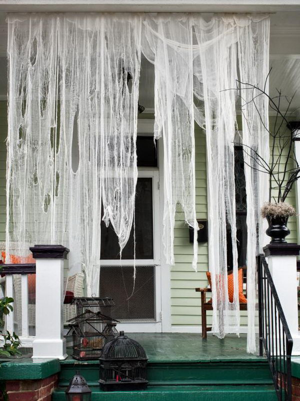 Spooktacular Front Porch With Drape Cheesecloth.