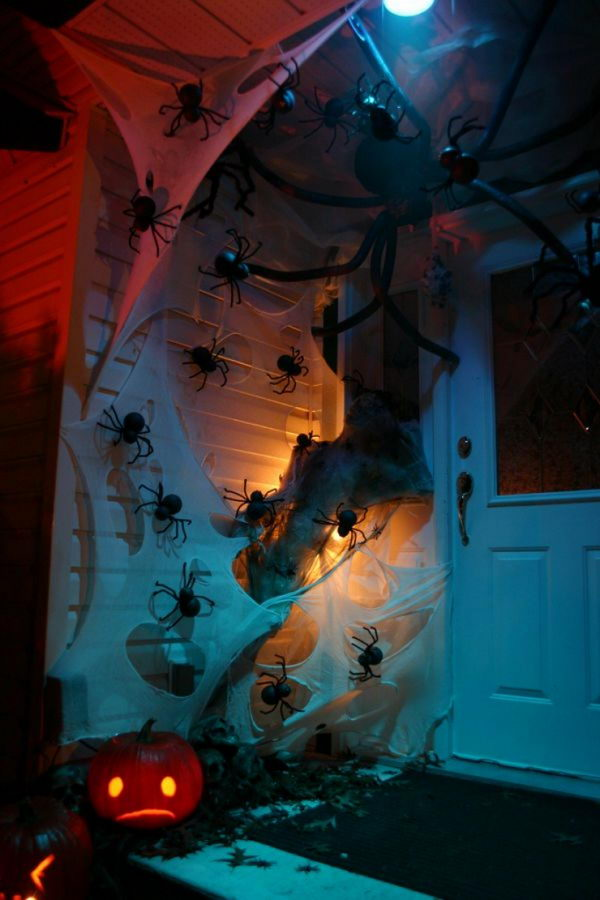 Spooky Front Porch Decor with Discount Store Spider Webs and Spiders.
