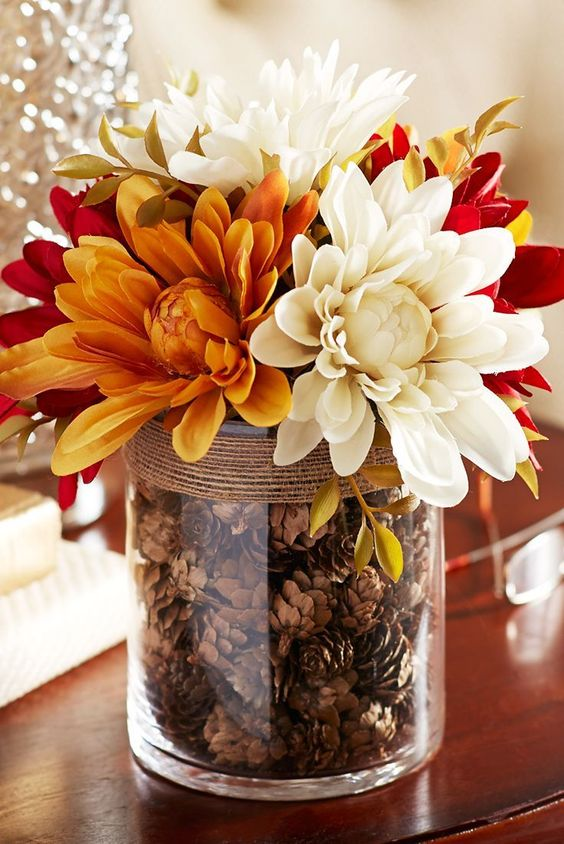 Faux Dahlias In A Pinecone Filled Vase.