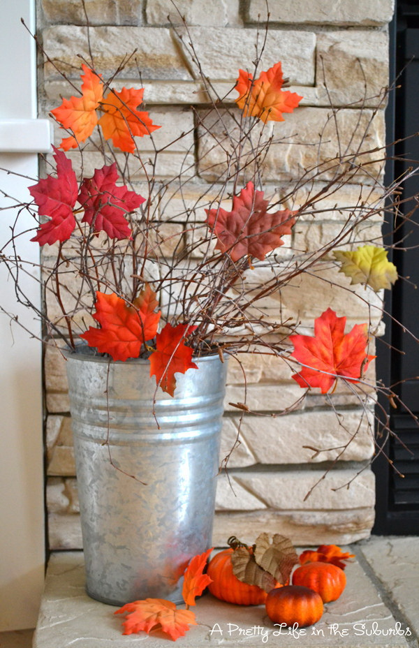 Faux Leaves And Branches Fall Centerpiece.