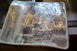 Use Plastic Wrap To Wrap Your Silverware In Its Holder For Easy To Pack And Easier To Unpack.