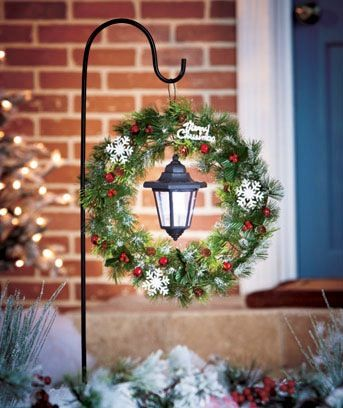 Hang A Christmas Wreath And A Solar Lantern On A Shepherd's Hook.