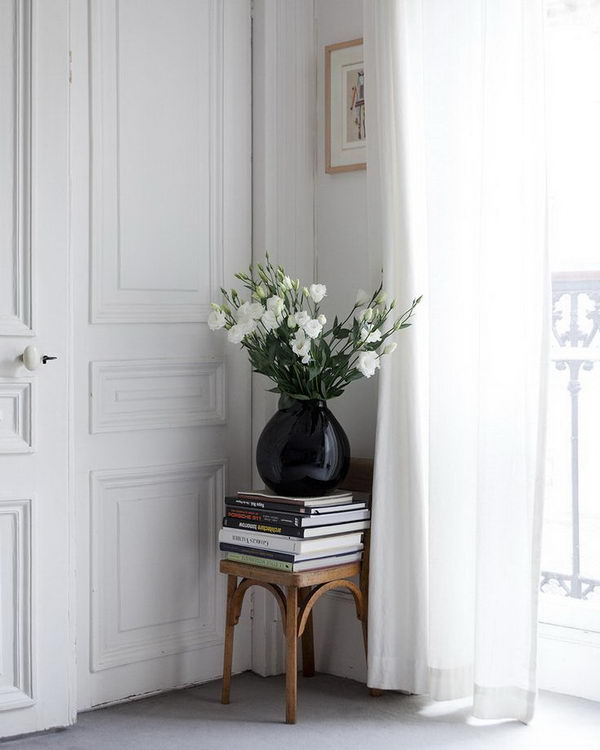 Small Chair With Books And Flowers.