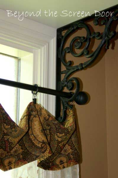 Repurpose iron brackets as curtain brackets for windows.
