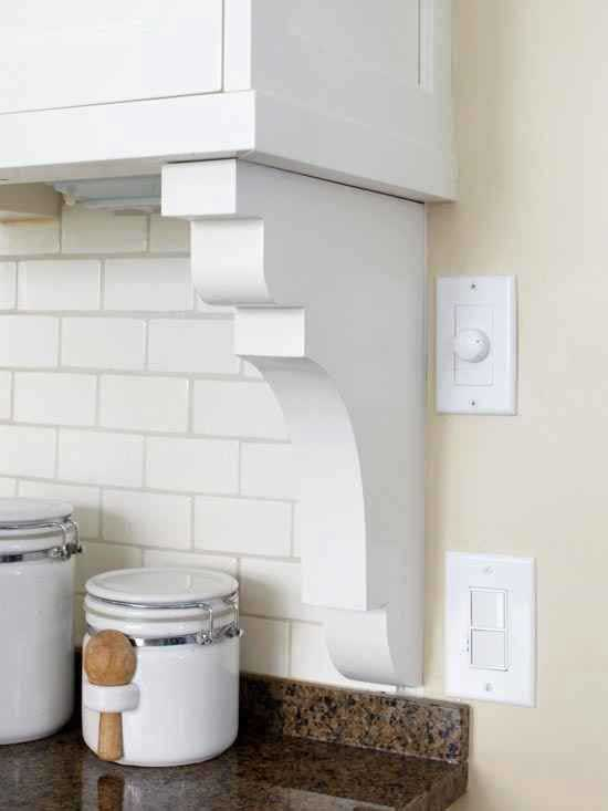 Adding a shelf bracket is a clever way to end the backsplash where the cabinet ends but the wall does not.