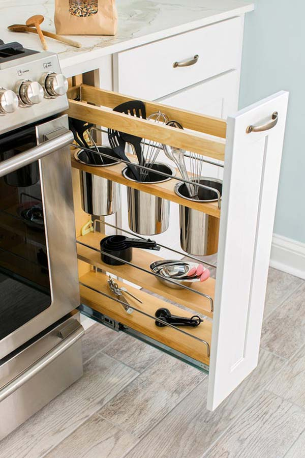 A narrow pullout cabinet with canisters for storing cooking or baking tools upright.