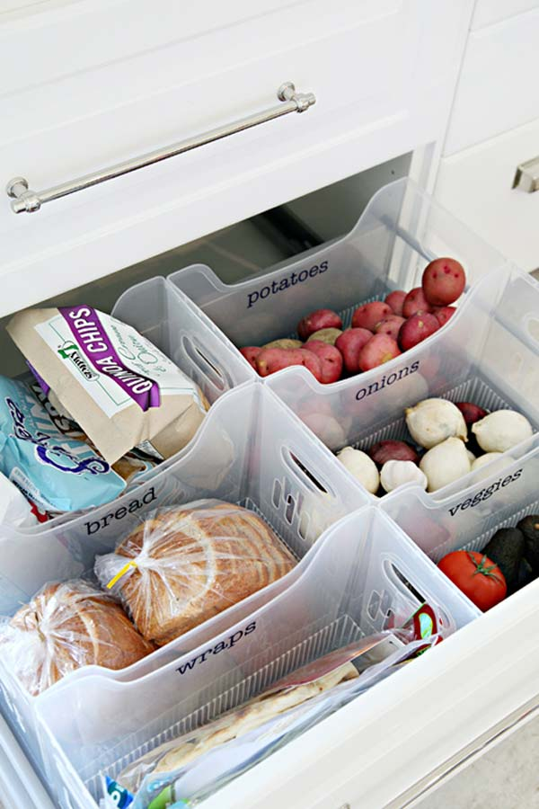 Turn a pull out drawer into a mini food pantry by using multi purpose bins.