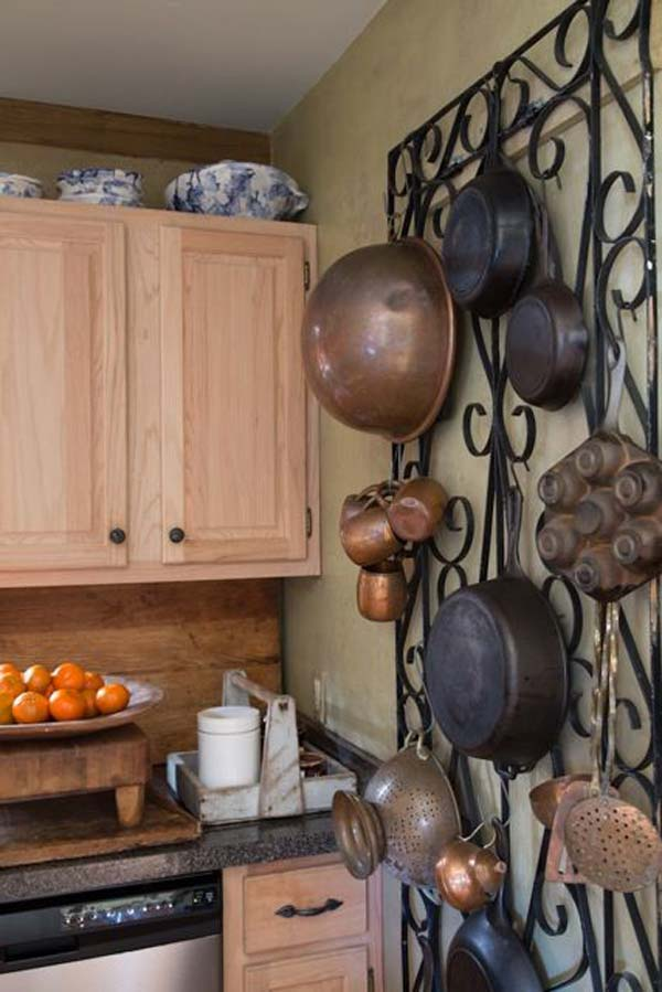 How about the iron garden trellis used as a pot rack.