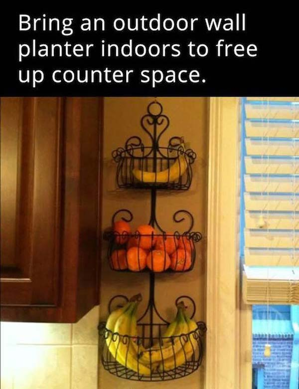 Bring an outdoor wall planter indoors to free up counter space.