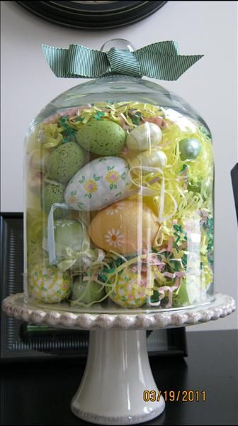 Easter centrepiece with tall glass cake pedestals.