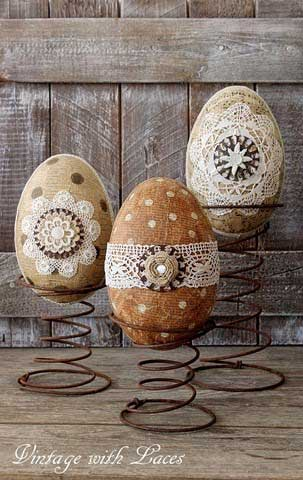 Paper mache Easter eggs on rusty bed springs.