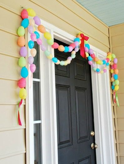 Front Door With Easter Egg Garland.