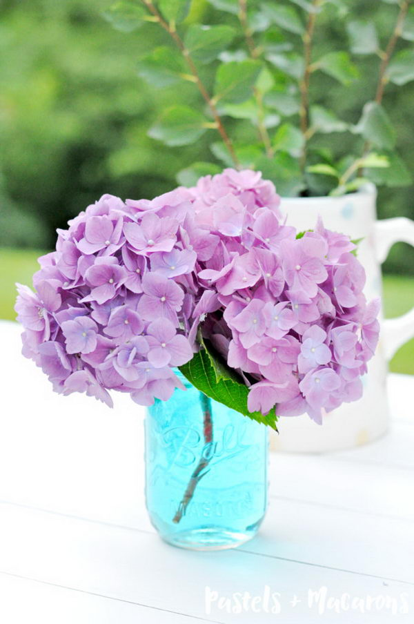 Blue Mason Jars With Purple Hydrangeas.