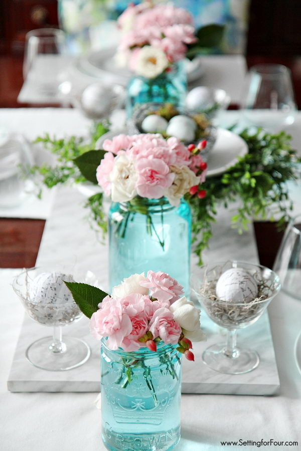 Blue Tinted Mason Jars With Pink Blossom.