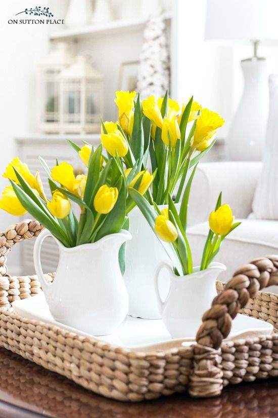 White Vases With Yellow Tulips Arrrangement.