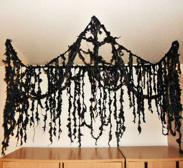 Hang These Black Garbage Bag Strips from The Ceiling.
