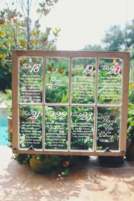 Seating chart made from an old hanging window.