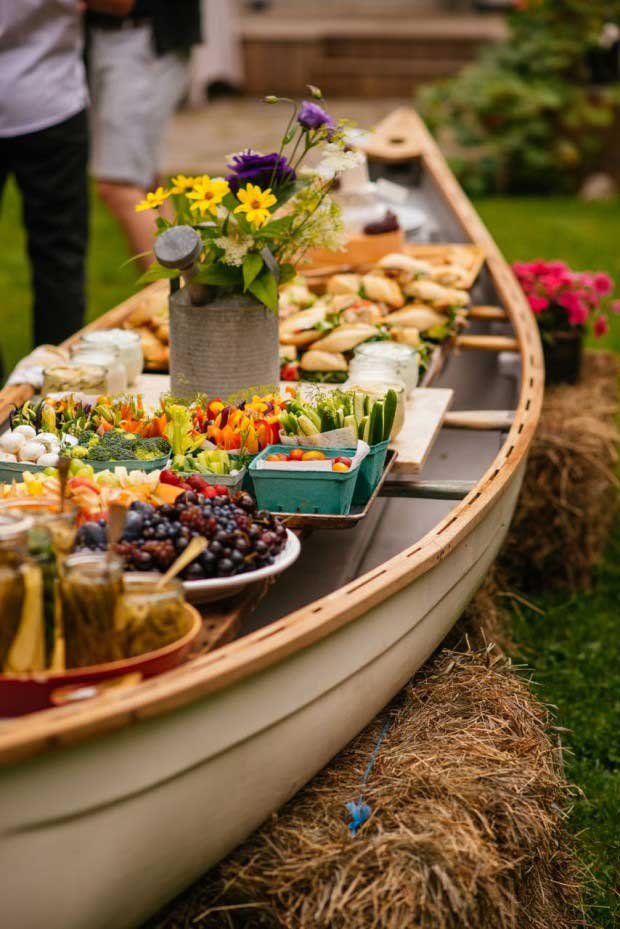 Set up an outdoor buffet in a canoe.