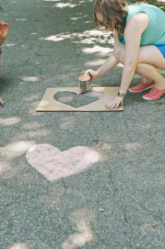 Tell your guests to follow the flour hearts made with food coloring and a stencil, to your ceremony.
