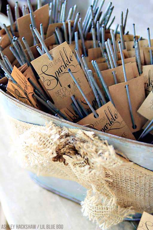 Sparklers and personalized matches as wedding guest favors.