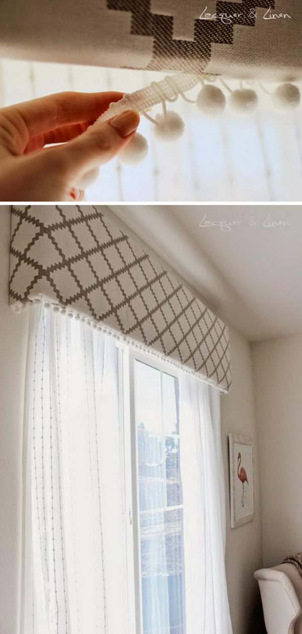 Fabric Covered Cornice Board With Pom Poms.